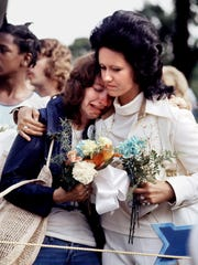 Bonnie Hutchings, left, of Rochester, N.Y., weeps and is supported by Mary Ann Thornton, of Kansas City, Kan., at Forest Hill Cemetery Midtown on Aug. 19, 1977, three days after Elvis Presley's death.
