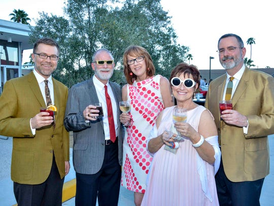 Folks in retro attire pose by the Sinatra pool during a Modernism Week event.