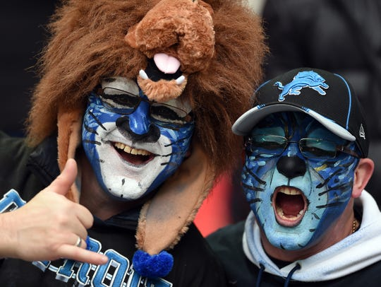 Detroit Lions fans with their faces painted in 2014.