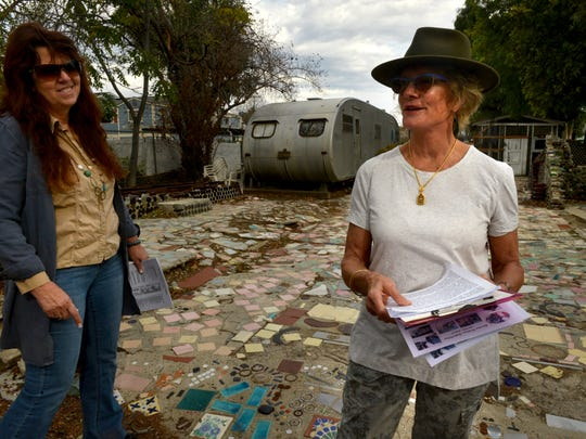 Drew Kennedy, left, and Francie Rehwald are tour guides at Grandma Prisbrey's Bottle Village in Simi Valley.