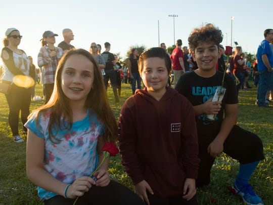 Parkland residents (left to right) Annie Coppola, 11, Dylan Shapiro, 11, and Matteo Battagliola, 10 attend a vigil at Parkland Amphitheater Thursday, Feb. 15, 2018, to remember those injured and killed, and their families, during yesterday's mass shooting at at Marjory Stoneman Douglas High School in Parkland.