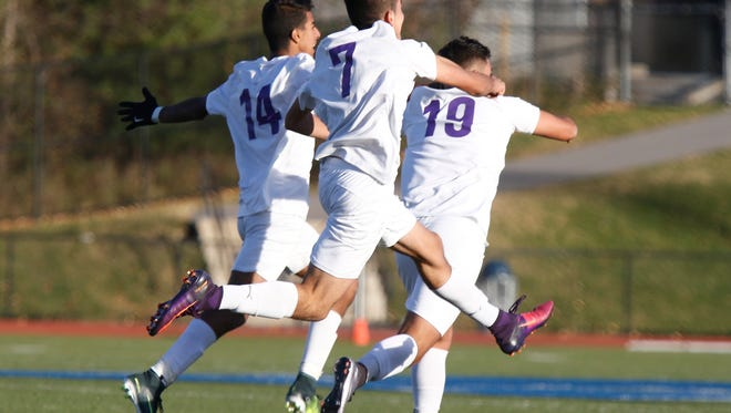 New Rochelle defeats Calhoun 4-3 in overtime in the Class AA boys state semi-final soccer match at Twin Towers Middle School on Saturday, November 12, 2016.