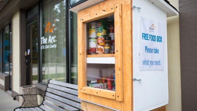 A box offering free food sits outside of The Arc of St. Clair County in Port Huron Friday, Oct. 27, 2017. The box offers free food and other items to members of the community who are in need.