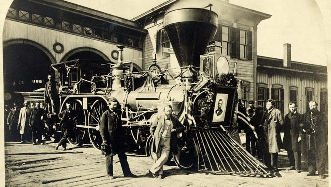 Photo shows a Cleveland, Columbus & Cincinnati Railroad engine, with a portrait of Abraham Lincoln mounted on the front. The engine was one of several used to carry Lincoln's body from Washington, D.C., to Springfield, Ill.