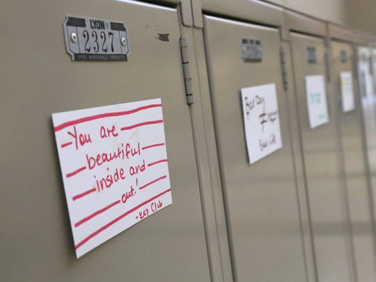 Notes of encouragement and support are put on over 1,000 lockers by the Mansfield Senior High School Key club on Thursday.
