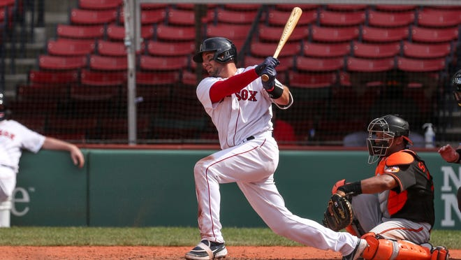 Red Sox catcher Kevin Plawecki hits an RBI single during the sixth inning against the Orioles on Saturday.