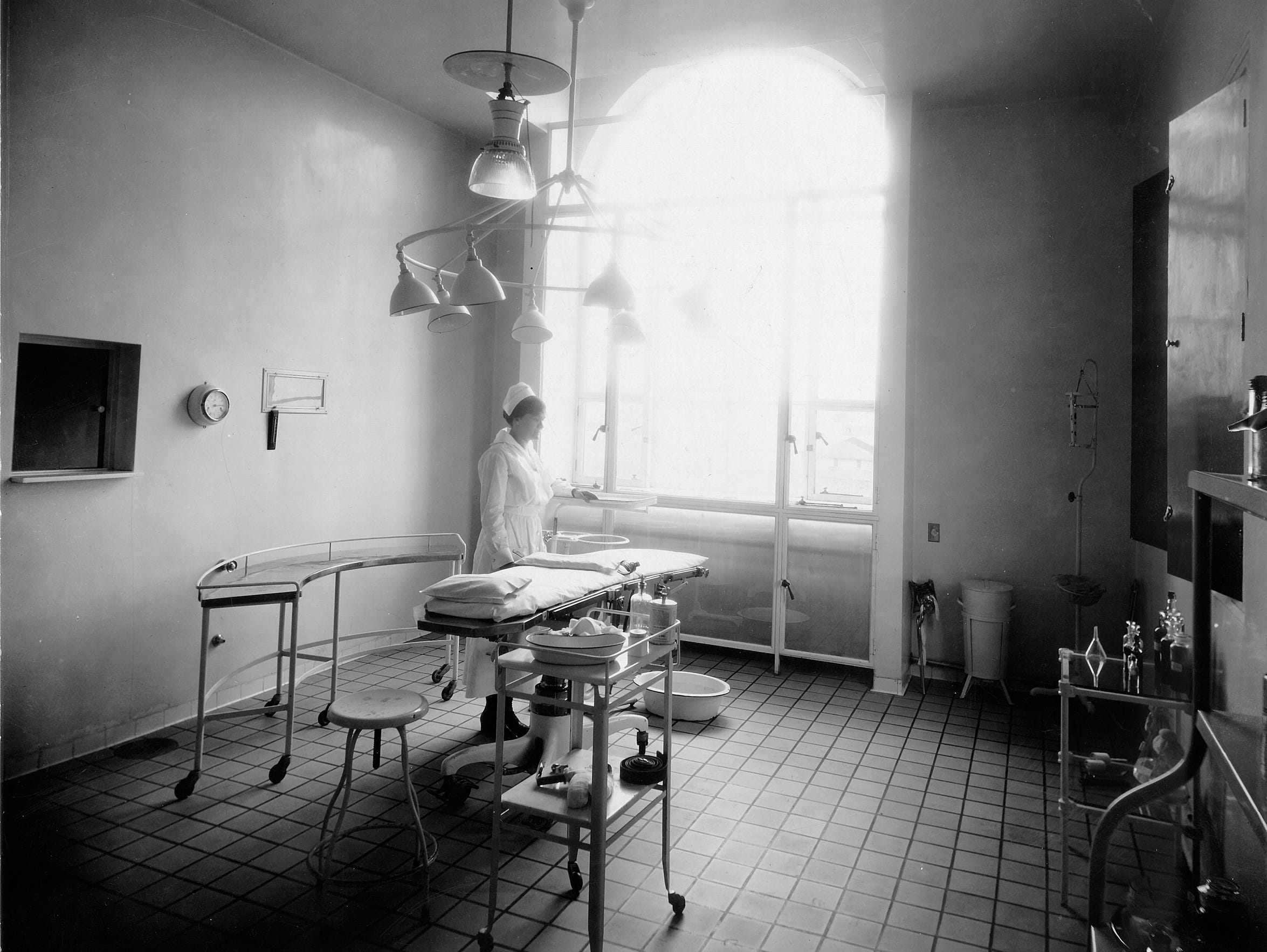 A woman in an operating room in the early days of Mansfield