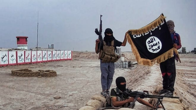 An image made available on a jihadist website this summer shows militants of the Islamic State of Iraq and the Levant with the trademark Jihadists flag in Iraq. U.S. officials are concerned IS supporters may attack Americans in the States.