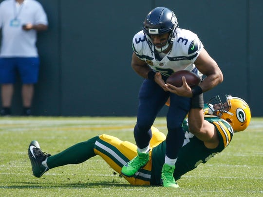 Russell Wilson was hit seven times and sacked three times by the Green Bay defense.