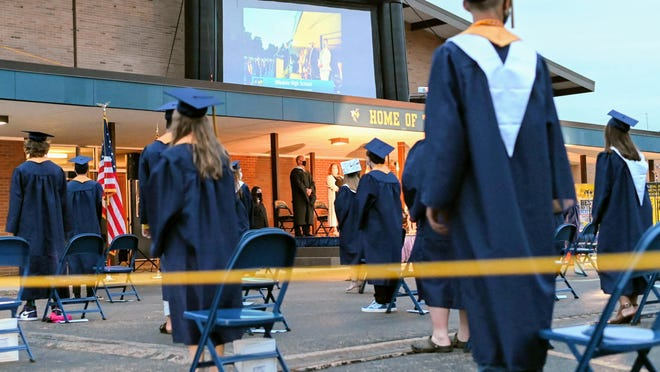 Hillsdale High School's Class of 2020 prepares to be seated during Friday's graduation ceremony. Sam Fry/Hillsdale Daily News.