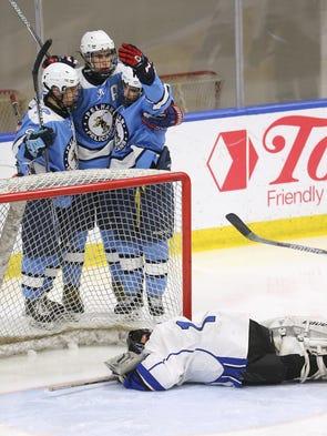 Dejected Brockport goalie Liam Schreiner lays  in the