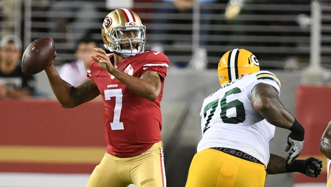 August 26, 2016; Santa Clara, CA, USA; San Francisco 49ers quarterback Colin Kaepernick (7) passes the football against Green Bay Packers defensive end Mike Daniels (76) during the second quarter at Levi's Stadium.