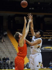 Southern Miss player Eddie Davis III rebounds the ball in a game against UTEP in Reed Green Coliseum on Saturday.
