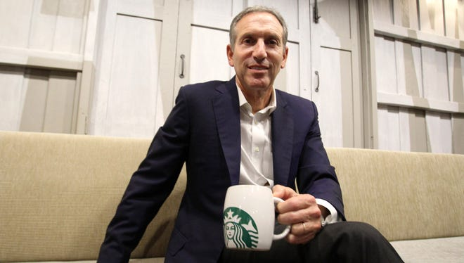 In this Monday, May 13, 2013, file photo, Starbucks CEO Howard Schultz poses for the photographer during a press conference in Bangkok, Thailand.