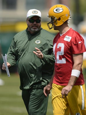 Green Bay Packers head coach Mike McCarthy and quarterback Aaron Rodgers talk during organized team activities June 2 at Clarke Hinkle Field.