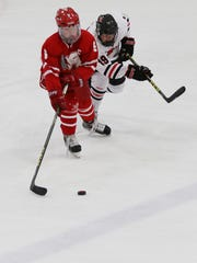 Wisconsin Rapids' defenseman Sam Storlie, left, was