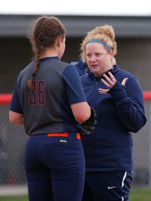 Harrison head coach Brooke El Othmani talks with pitcher Maren Fodrea before facing Frontier in the bottom of the second inning Wednesday, May 4, 2016, at Frontier High School in Chalmers. Harrison defeated Frontier 4-3.