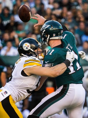 Eagles quarterback Carson Wentz is hit as he throws by Steelers linebacker Anthony Chickillo in the second quarter of a 2016 game between the Philadelphia Eagles and Pittsburgh Steelers.