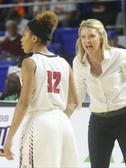 Stewarts Creek coach Lindy King gives instruction to senior Brianah Ferby during the Class AAA state tournament.