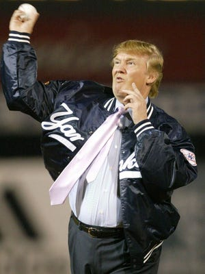 Trump throws out the first pitch at a Yankees spring training game in 2004.