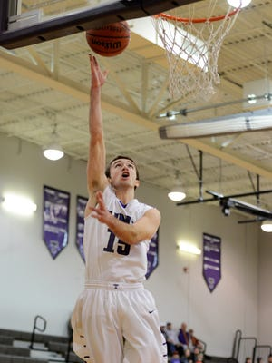 Trinity Christian Academy's Alex Northcut goes up for a lay-up during Tuesday night's game against Carver (Memphis).