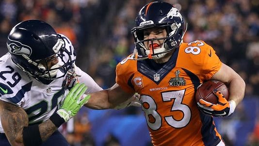 EAST RUTHERFORD, NJ - FEBRUARY 02: Wide receiver Wes Welker #83 of the Denver Broncos tries to avoid the tackle of free safety Earl Thomas #29 of the Seattle Seahawks during Super Bowl XLVIII at MetLife Stadium on February 2, 2014 in East Rutherford, New Jersey.