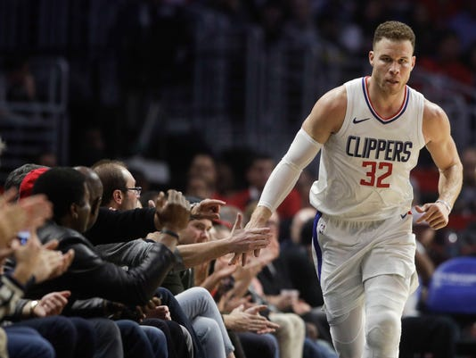 Los Angeles Clippers' Blake Griffin makes his way up the court after making a basket during the first half of an NBA basketball game against the Memphis Grizzlies on Tuesday, Jan. 2, 2018, in Los Angeles. (AP Photo/Jae C. Hong)