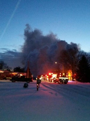 A house burns in Fowlerville early Friday.