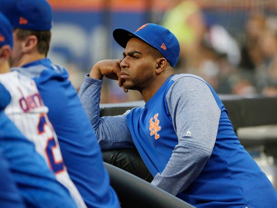 New York Mets' Yoenis Cespedes watches his team play the San Diego Padres during the first inning of a baseball game Tuesday, July 24, 2018, in New York. (AP Photo/Frank Franklin II)