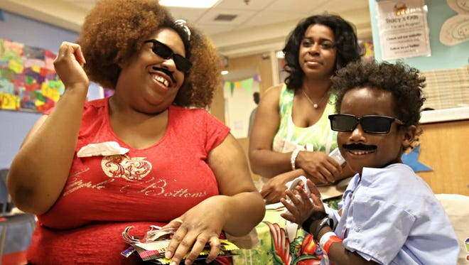 Patients tried on spy disguises.  The Hope for Henry Foundation hosted a day of intrigue with The International Spy Museum for the kids and families at the Center for Cancer and Blood Disorders at Children's National Health System.
