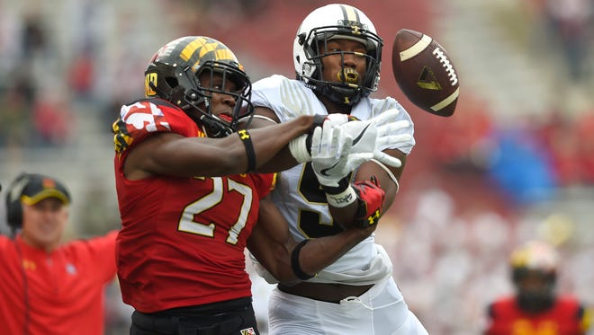 Maryland defensive back Alvin Hill (27) breaks up a pass intended for Purdue wide receiver Domonique Young (5) during the first quarter at Byrd Stadium.