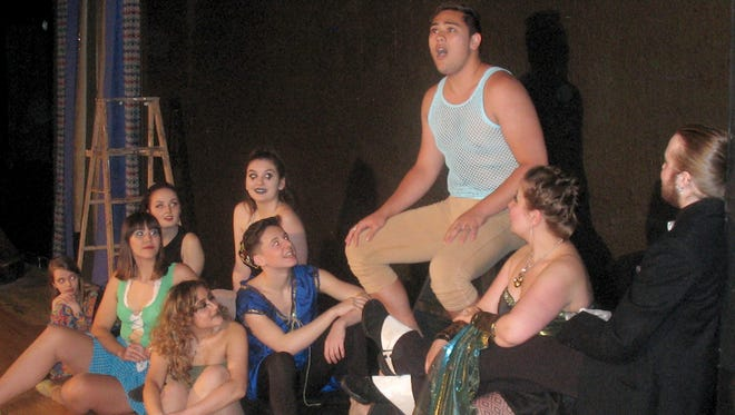Pippin (Dylan Macabitas, top) gets the undivided attention of the Players.