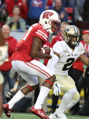 Wisconsin sophomore receiver Quintez Cephus  picks up a long gain in the second half on his way to a five-catch, 100-yard day.