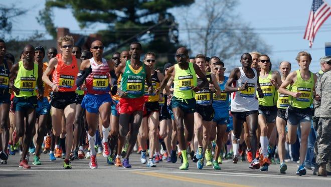 The elite men's runners race near the start of the 118th Boston Marathon Monday, April 21, 2014 in Hopkinton, Mass. (AP Photo/Michael Dwyer)
