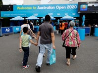 Spectators arrive at Melbourne Park as qualifying matches for the Australian Open tennis championship continue in Melbourne, Australia, Friday, Jan. 17, 2020. The season's opening Grand Slam event begins here Monday Jan. 20. (AP Photo/Mark Baker)