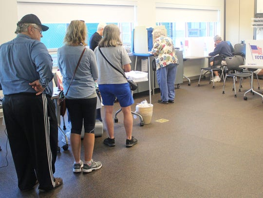 Voters line up at the North Liberty Community Center