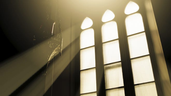 Rays of light through glass in a window church