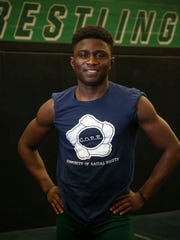 Meshach Zarwie, a student at Des Moines North High and a leader on the North Hoover wrestling team, is a refugee who immigrated to the United States from the Ivory Coast when he was young. He will wrestle for Iowa State University after he graduates from North.