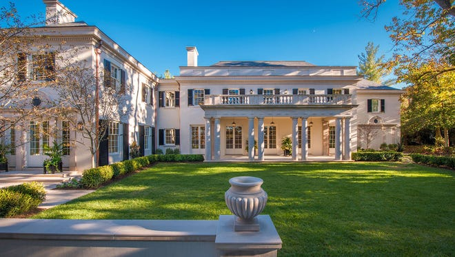 An eight-bedroom mansion featuring Indiana limestone is for sale for $22 million in Northwest Washington's Kent, Tuesday, April 25, 2017.