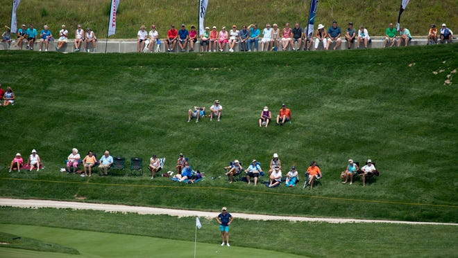 Golf fans perched near the 18th green at the Pat Dye Course during the first round of the Senior LPGA Championship in French Lick, Ind., Monday afternoon.