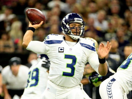 Russell Wilson has battled injuries all year, but he's still completing 65.6 percent of his passes.