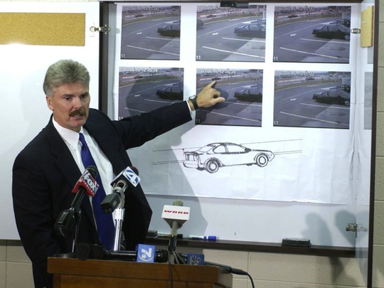 Greer Police Chief Dean Crisp shows a drawing and photos of the car that is suspected of being involved in the murders and robbery at Blue Ridge Savings Bank in 2003.