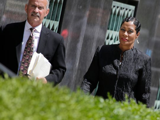 Monica Morgan walks into the federal courthouse in