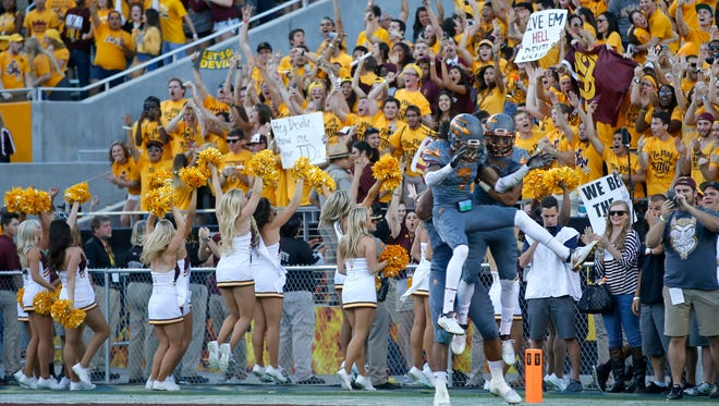 Arizona State University Solomon Means,  left, and Lloyd Carrington, right, celebrate a touchdown in the fourth quarter during the Territorial Cup game against University of Arizona at Sun Devil Stadium in Tempe on November 21, 2015.