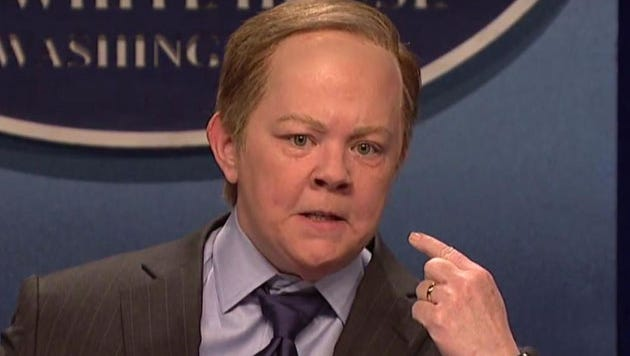 Melissa McCarthy as Sean Spicer.