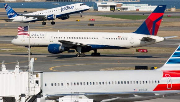 JetBlue, Delta and American airlines planes are seen