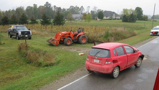 A car and a tractor were involved in a crash in Greenleaf Township.