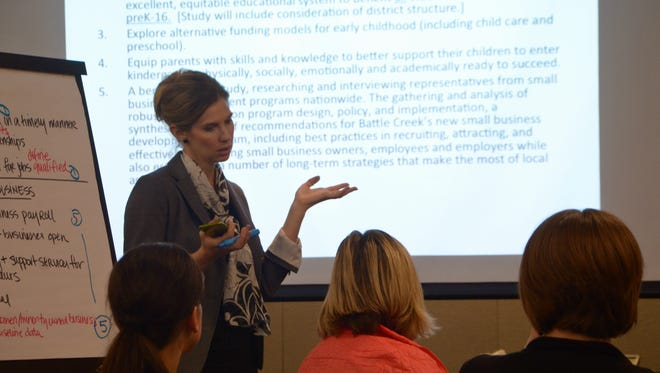 Megan Russell Johnson, a co-lead for grantmaking efforts for the W.K. Kellogg Foundation, leads a BC Vision meeting Wednesday in downtown Battle Creek.
