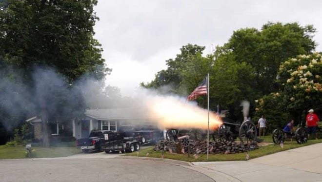 Frank Markel pulls a lanyard to fire one of four cannons he owns in his front yard, located at 4004 Shady Lane Court, on July 4, 2016, in Greenfield.