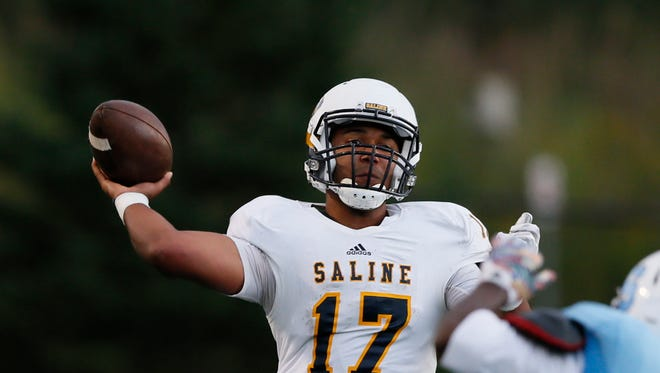 Saline quarterback Josh Jackson throws a pass under pressure for an incompletion in the second quarter against Ann Arbor Skyline on Sept. 11, 2015, in Ann Arbor.